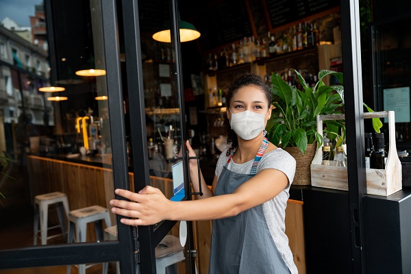 Row 1.jpg (Happy business owner opening the door at a cafe wearing a facemask)